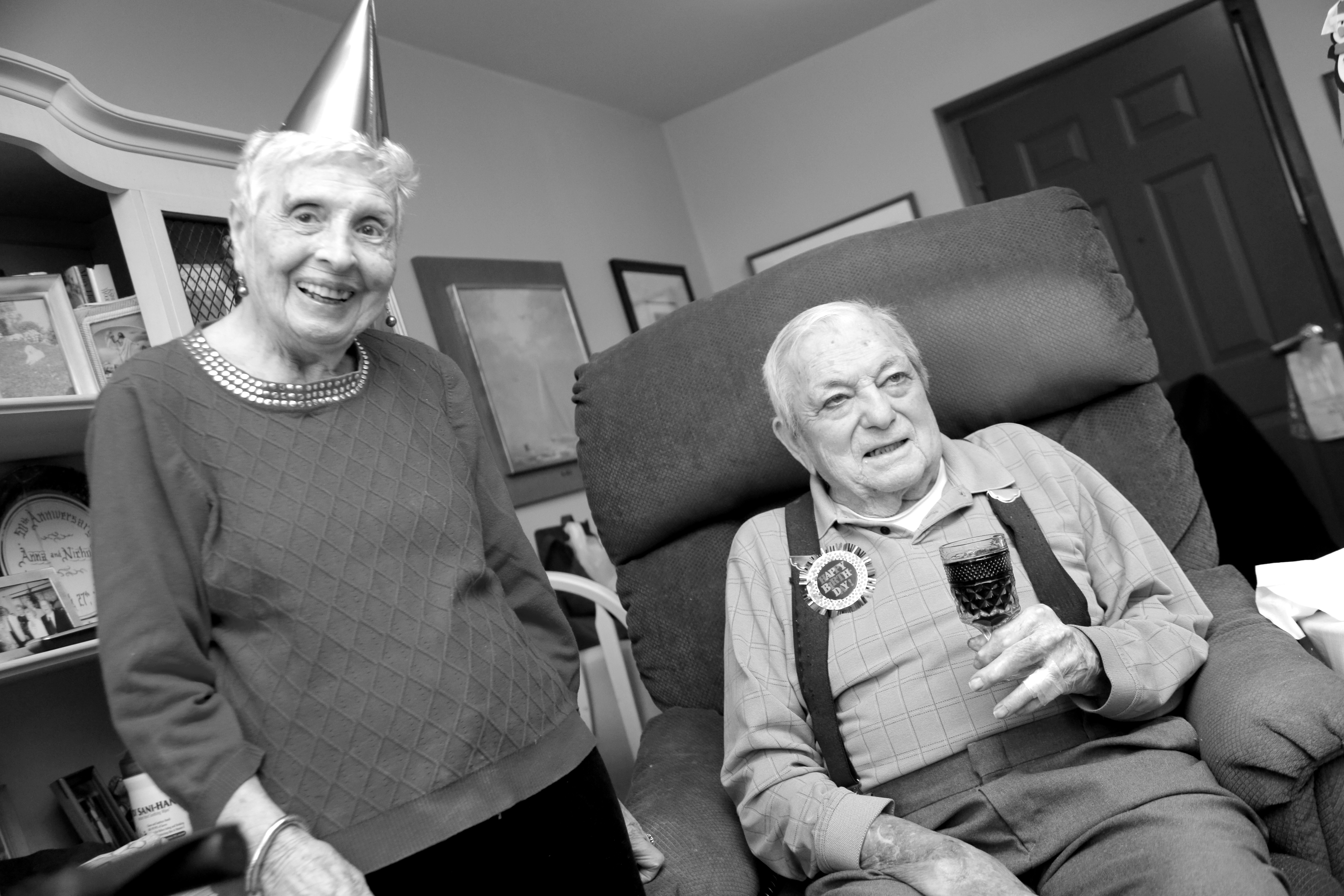 Dan Moracarco, a World War II Air Force Veteran with his wife Marie celebrating his 98th birthday with his home health care aides from Community Home Health Care