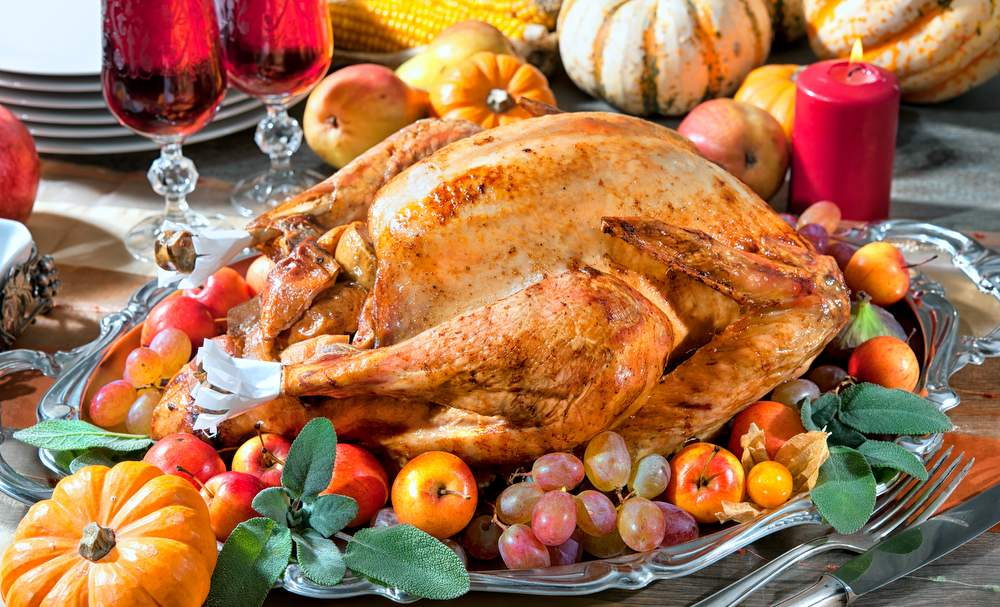 healthy thanksgiving dinner. roasted turkey on holiday table with pumpkins and vegetables. healthy living. happy thanksgiving.