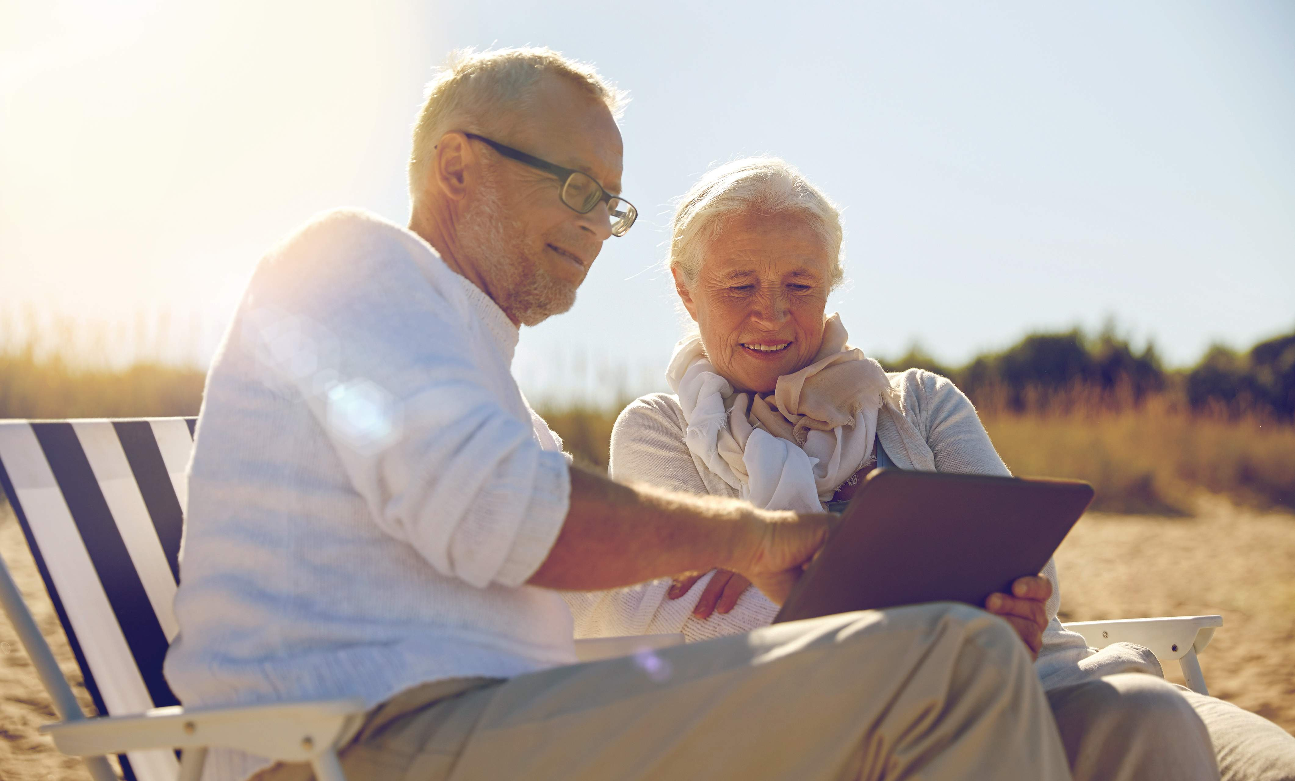 senior couple planning retirement on beach